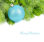 Blue Christmas ball on fluffy branches of a Christmas tree on a white background. A Christmas background with a place for the text. — Stock Photo