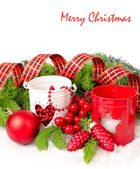 Red and white candlesticks, Christmas ball and cones on branches of a Christmas tree on a white background. A Christmas background with a place for the text. — Stock Photo