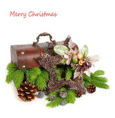 Wooden chest with branches of a Christmas tree and a decorative Christmas star on a white background. A Christmas background with a place for the text. — Stock Photo