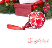 Red Christmas ball close up on a white background. A Christmas background with a place for the text. — Stock Photo