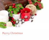 Red and white candlesticks and coils of lace near a wooden chest on a white background. A Christmas background with a place for the text. — Stock Photo