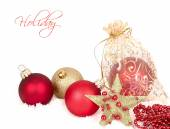 Red and golden Christmas balls and gold star on snow on a white background. A Christmas background with a place for the text. — Stock Photo