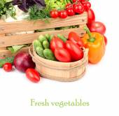 Fresh ripe vegetables in a wooden box on a white background with a place for the text. — Stock Photo