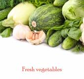 Fresh green vegetables on a white background with a place for the text. — Stock Photo