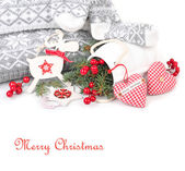 Christmas background with red-white jewelry in the Scandinavian style on a white background with a place for the text. The Scandinavian style in an interior. — Stock Photo