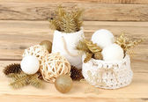 Christmas composition with golden branches of a Christmas tree and white Christmas balls on a wooden background. Christmas background. — Stock Photo