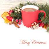 Red mug of hot chocolate on snow on a white background. A Christmas background with a place for the text. — Stock Photo