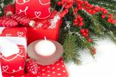 Red gift box with a white bow on a white background. A Christmas background with a place for the text. — Stock Photo