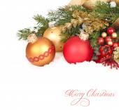 Christmas composition with gold and red Christmas balls and tapes on snow-covered branches of a Christmas tree on a white background. A Christmas background with a place for the text. — Stock Photo