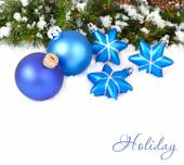 Blue Christmas balls and stars and branches of a Christmas tree on a white background. A Christmas background with a place for the text. — Stock Photo