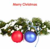 Blue and red Christmas balls and branches of a Christmas tree on a white background. A Christmas background with a place for the text. — Stock Photo