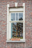 Window in the red brick house — Stock Photo