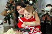 Christmas . Сhildren with a tablet  PC — Stock Photo