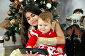 Christmas .Сhildren with a tablet PC — Stock Photo