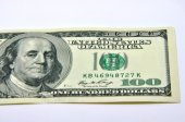 American 100 U.S. dollars on a white background — Stock Photo