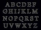 Gray alphabet on a black background — Stock Photo