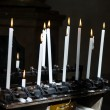White Candle flames on a black background — Stock Photo #67542003