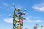 Communications tower colorful Blue Sky — Stock Photo