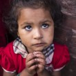 BHAKTAPUR, NEPAL-OCT 14 , 2012 : the little girl is asking for t — Stock Photo #72377923