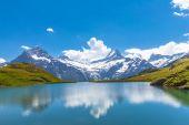Bachalpsee and the snow peaks of Jungfrau region — Stock Photo