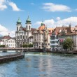 Jesuitenkirche (church) on the river side of Reuss — Stock Photo #63822963
