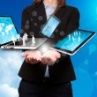 Businesswoman holds modern technology in hands - Stock Image — Stock Photo #62683685