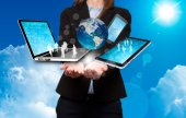 Businesswoman holds modern technology in hands - Stock Image — Stock Photo