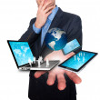 Businessman holds modern technology in hands - Stock Image — ストック写真 #64166107