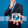 Earth  in front of businessman. Touch screen consept - Stock Image — Stockfoto #64166147