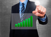 Businessman in dark suit pushing button, visual screen Growth graph. — Stock Photo