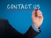 Businessman hand writing contact us — Stock fotografie