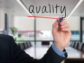 Businessman hand writing quality in the air - Stock image — Fotografia Stock
