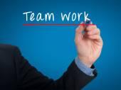 Team work concept businessman hand writing Team work  - Stock image — Stockfoto