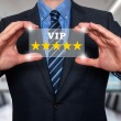Businessman holds vip five stars in his hands- Stock Image — Stock Photo #65443975