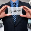 Businessman holding Quality sign. Isolated on various backgrounds- Stock Photo — Stock Photo #68363747