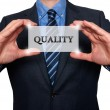 Businessman holding Quality sign. Isolated on various backgrounds- Stock Photo — Stock Photo #68363821