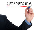 Businessman hand writing Outsourcing. Business concept.Stock Photo — Photo