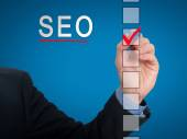 Businessman checking mark on SEO checklist marker. Checking SEO. Isolated on  background, Stock Photo — Stock Photo