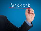 Businessman hand writing Feedback in the air  - Stock PImage — Zdjęcie stockowe