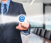 Businessman pressing mail button on visual screen. Customer support concept. Stock Image — Stock Photo