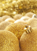 Gold Christmas decorations — Stock Photo