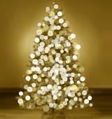 Bokeh silhouette of Christmas tree — Stock Photo