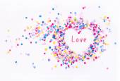 Heart shape in confetti with sample text, love — Stock Photo
