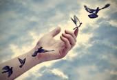 Bird tattoos come to life, conceptual — Stock Photo