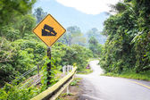 Warning steep road sign slope and truck on hill. — Stock Photo