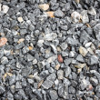 Crushed stone abstract textured background — Stock Photo #62822861