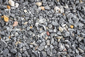Crushed stone abstract textured background — Stock Photo