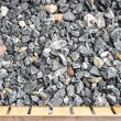 Old wood table and crushed stone abstract textured background — Stock Photo #62837101