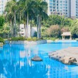 Pool, palm tree and building — Stock Photo #63951705