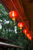 Red Chinese lantern hanging on the roof — Stock Photo